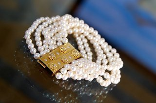 seven-strands-of-pearls-attached-to-gold-clasp