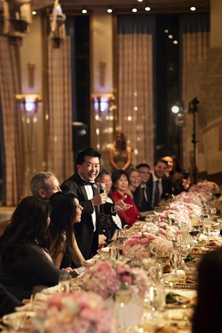 wedding-guest-giving-speech-with-microphone-at-table