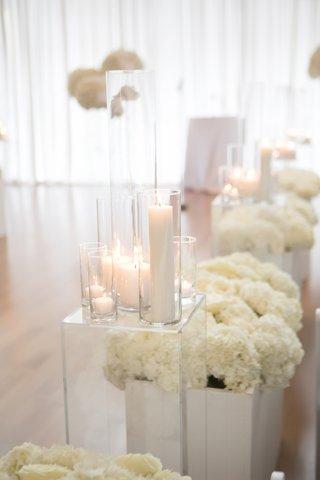 wedding ceremony aisle decorations lucite riser candles white hydrangea flowers