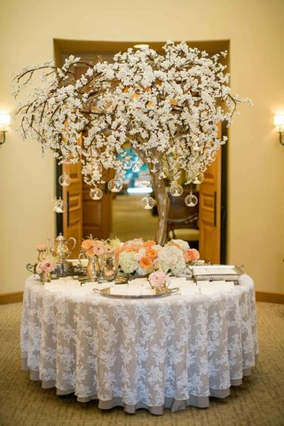 treelike-structure-with-hanging-votives-and-silver