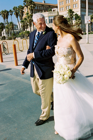 bride-on-fathers-arm-in-santa-monica-california