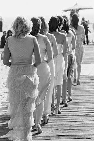 black-and-white-picture-of-mismatched-bridesmaids-on-beach