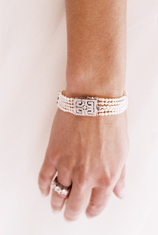 bracelet-with-silver-clasp-and-rows-of-pearls