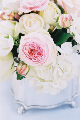 blush-and-white-flowers-in-metallic-vase