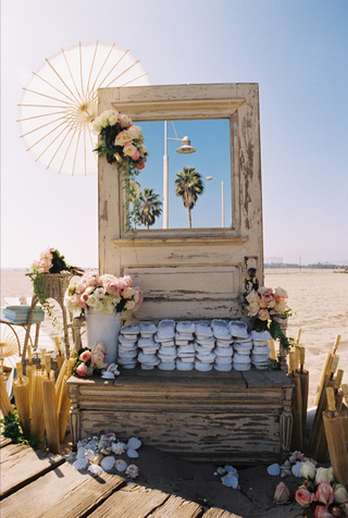 ceremony-parasols-and-slippers-on-rustic-beach-display