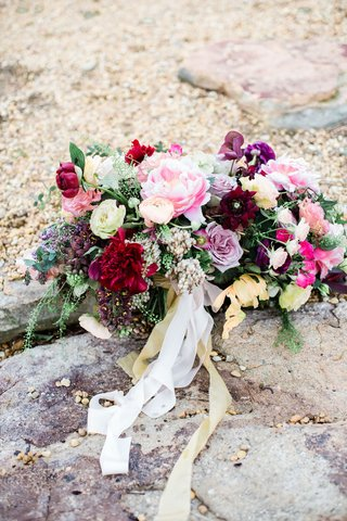 large-bridal-bouquet-in-shades-of-pink-burgundy-purple-and-yellow-accents