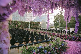 luxury las vegas wedding ceremony with purple flowers by andrea eppolito events