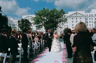 father-of-the-bride-escorts-bride-down-aisle