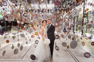 wedding couple bride in oscar de la renta gown at carriageworks australia sydney art institute