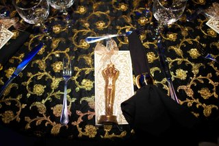 wedding-favor-of-a-chocolate-statuette-dusted-in-14k-gold