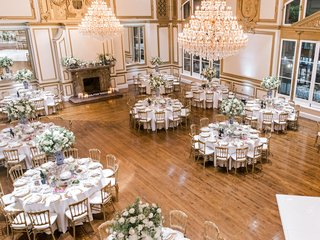 wedding-reception-ballroom-chandelier-fireplace-los-angeles-downtown-blue-white-vase-gold-details
