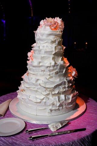white-ruffle-cake-with-pink-sugar-flowers