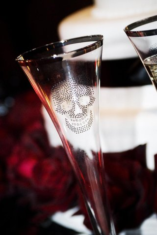 champagne-flute-with-a-silver-rim-and-skull-graphic