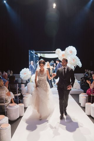 modern jewish wedding ceremony white aisle lanterns and large paper flowers lucite chuppah
