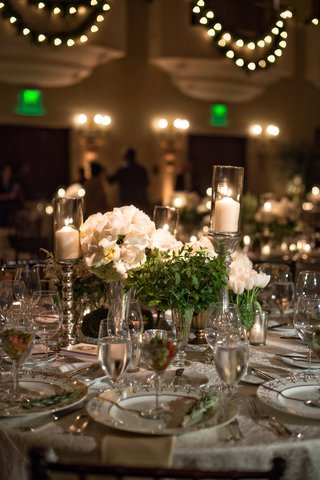 centerpieces-with-white-roses-greenery-and-candles