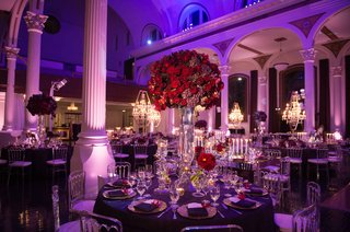 vibiana-wedding-reception-with-round-purple-table-and-tall-red-flower-arrangement-centerpiece