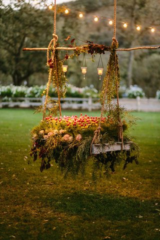 grilled-vegetable-garden-on-swing-rustic-chic-wedding-professional-event-lights-votives-california