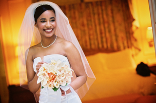 elbow-length-veil-with-hair-up-and-sparkling-necklace