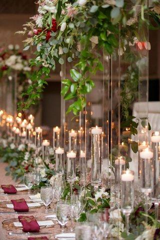 wedding-reception-tall-centerpiece-greenery-burgundy-flower-napkin-candles-floating-fall-wedding