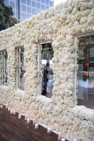 wedding-reception-white-hydrangea-rose-flower-wall-mirror-seating-chart-etched-with-names-candles