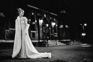 black-and-white-photo-of-bride-in-monique-lhuiller-gown-and-fur-lined-cape