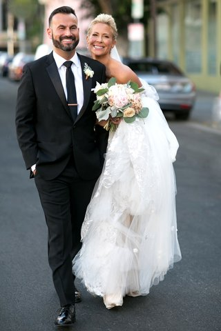 brittany-daniel-actress-on-wedding-day-with-bouquet-and-groom-in-suit-and-tie-in-downtown-los-angele