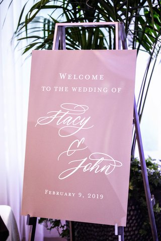 pink-purple-wedding-welcome-sign-for-stacy-john-silver-easel-hotel-wedding