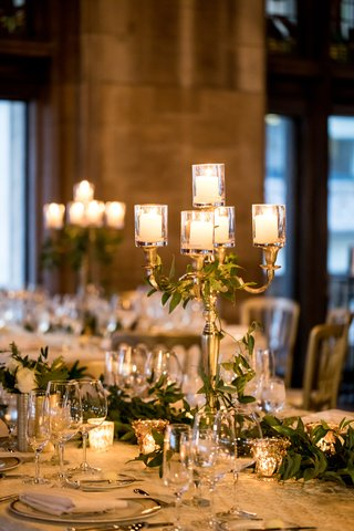 gold-candelabra-with-leaves-intertwined-small-pillar-candles