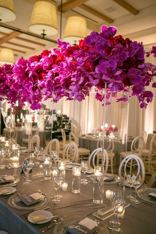 tall-blossoms-atop-clear-structure-tablescape-california-wedding-reception-tropical-unique-colors