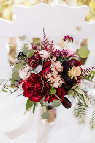 marsala-wine-colored-bouquet-with-deep-hues-of-red-purple-ivory-and-pink-with-greenery