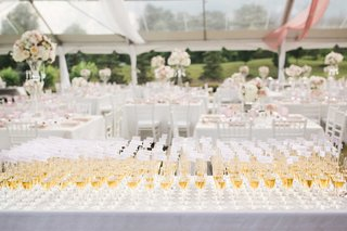 table-full-of-glasses-of-champagne-with-flags-in-the-flutes