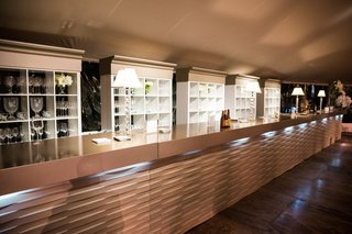 bar-with-geometric-design-and-glassware-shelves