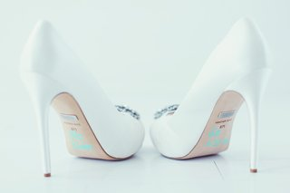 bridal-white-badgley-mischka-stilettos-with-her-new-married-name-on-sole-and-wedding-date