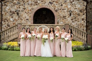 bride-with-eight-bridesmaids-wearing-light-pink-gowns