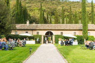 destination-wedding-reception-in-italy-parasols-and-wrought-iron-outdoor-garden-furniture-lawn-trees