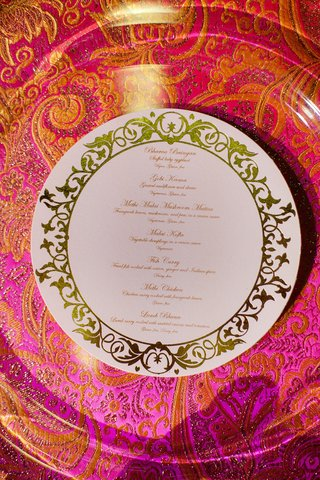 white-and-gold-circular-menu-card-on-silk-linens