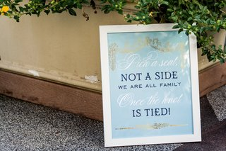 sky-blue-ceremony-sign-for-opening-seating-at-wedding-pick-a-seat-not-a-side