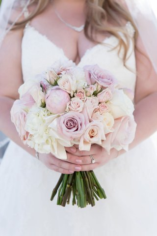 bride-in-v-neck-ball-gown-with-necklace-carrying-blush-lavender-ivory-bouquet-of-rose-peony-flowers