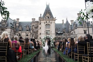 wedding-ceremony-at-the-biltmore-estate-in-asheville-north-carolina-black-aisle-runner-gold-crest