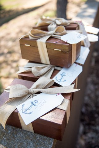 seaside-wedding-with-wood-boxes-tan-ribbons-name-tags-with-anchor-print-for-groomsmen
