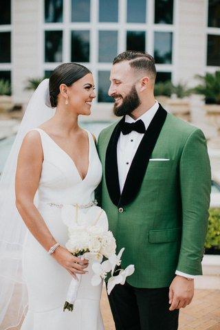 wedding-portrait-bride-and-groom-miami-florida-v-neck-wedding-dress-green-tuxedo-jacket-black-lapels