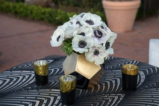 wedding-reception-outdoor-cocktail-hour-art-deco-linens-with-gold-black-candles-and-gold-vase