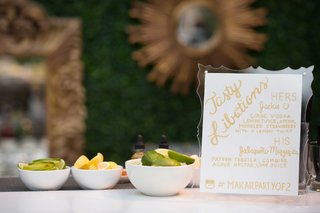 signature-cocktail-menu-at-outdoor-venue-with-his-and-hers-wedding-drinks