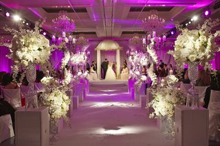 indoor-ceremony-with-bright-pink-uplighting