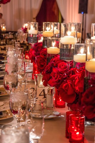 floating-candles-and-red-roses-on-long-tables
