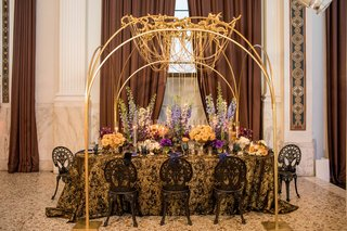 wedding-styled-shoot-gold-chain-chandelier-blue-delphiniums-black-and-gold