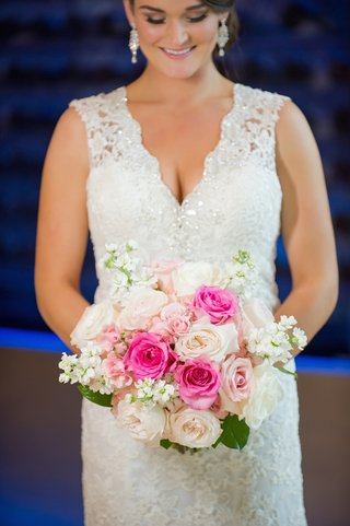 bride-wearing-sparkling-gown-and-holding-pink-flowers