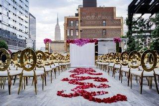 gold-chairs-white-cushions-flower-petal-swirl-aisle-runner-white-drape-altar-brick-skyline-empire