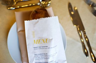 wedding-reception-menu-printed-on-bread-bag-at-each-guests-place-setting