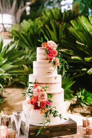 semi-naked-frosted-wedding-cake-five-layers-fresh-greenery-pink-orange-flowers-wood-stand